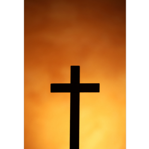 Picture of a cross with sunset background